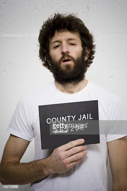 Man with beard holding blank sign