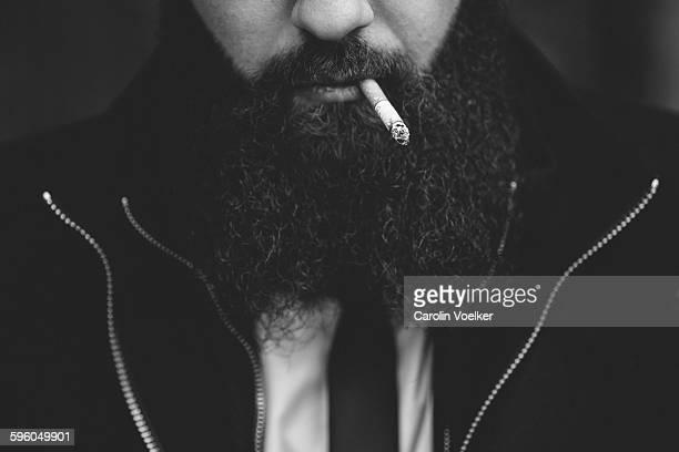 Man with beard smoking