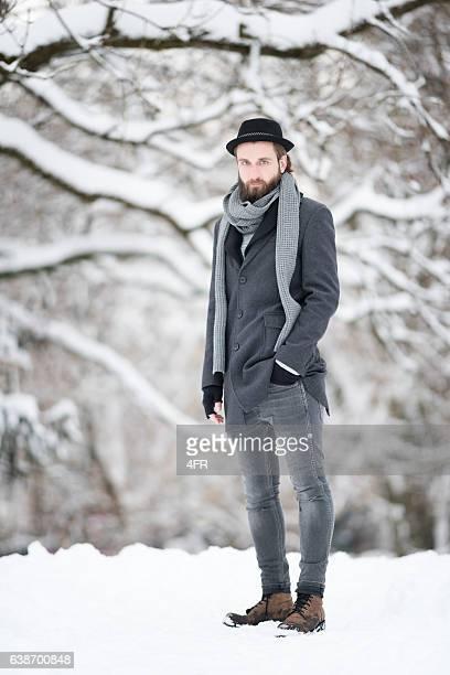 Man with Beard walking through the Snow, Winter Fashion
