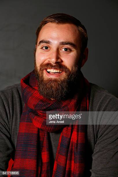 Man With Beard Wearing Plaid Scarf Smiling