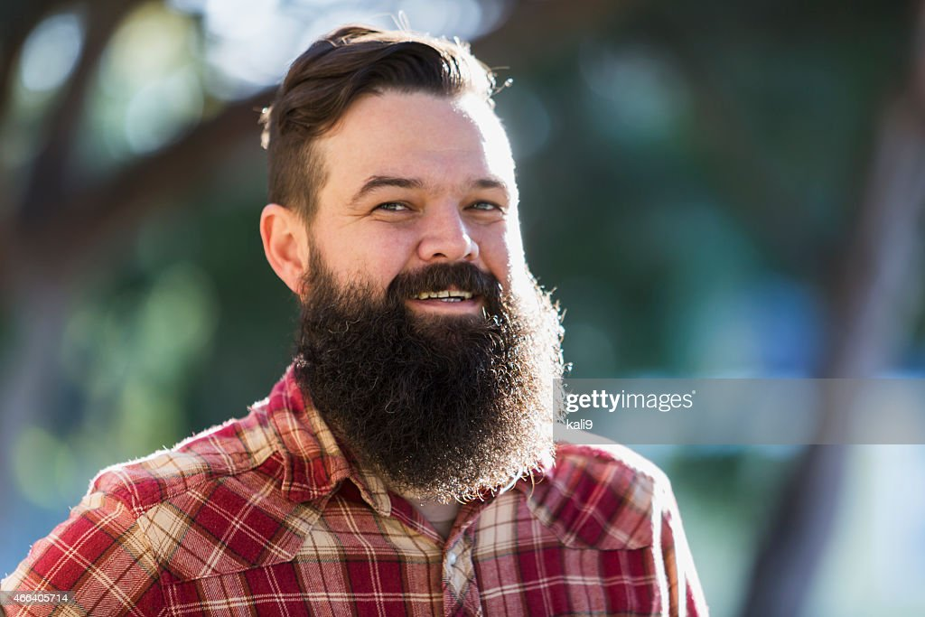 Man with beard wearing plaid shirt : Stock Photo