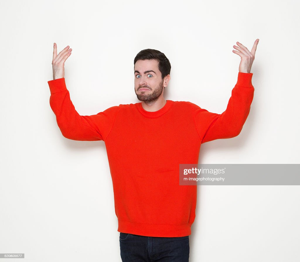 Man with beard with arms raised : Stock Photo