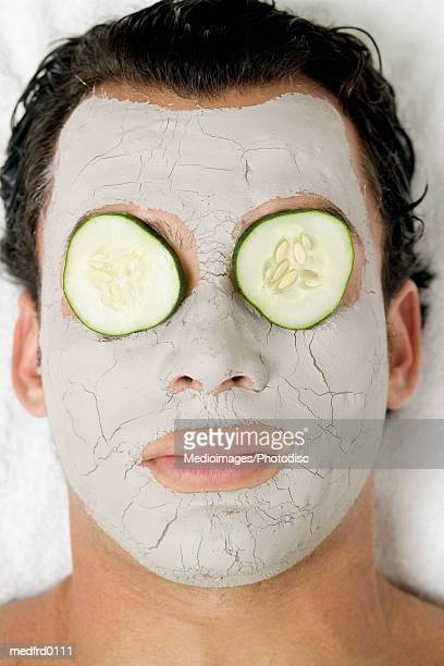 Man with beauty mask on face, extreme close-up