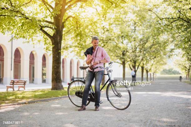 Man with bicycle in a park having a break