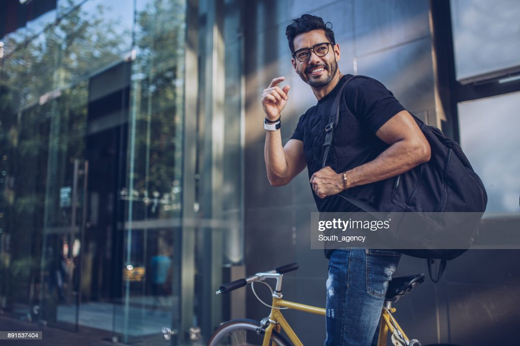 Man with bicycle in city : Stock Photo