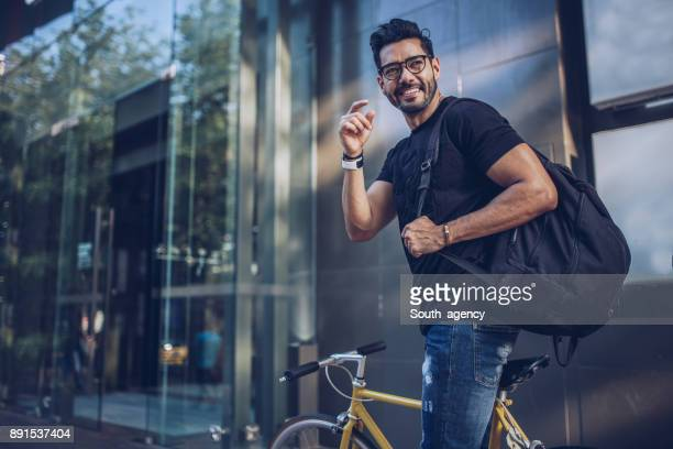 Man with bicycle in city