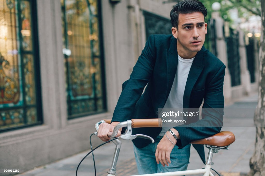 Man with bicycle : Stock Photo
