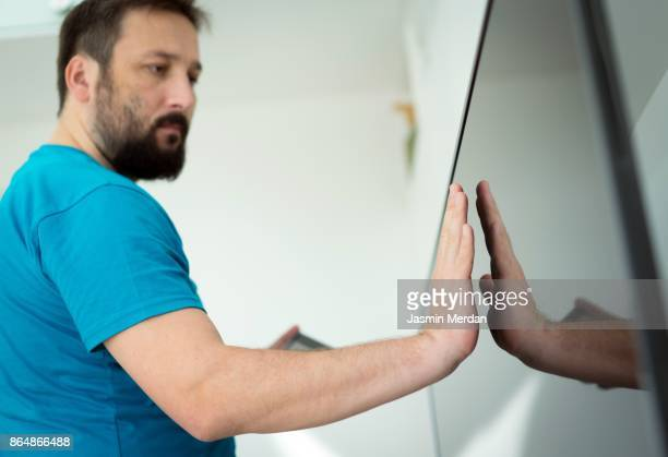 Man with big touch screen for smart home functions