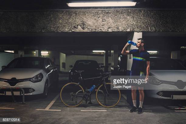 Man with Bike in Car Park