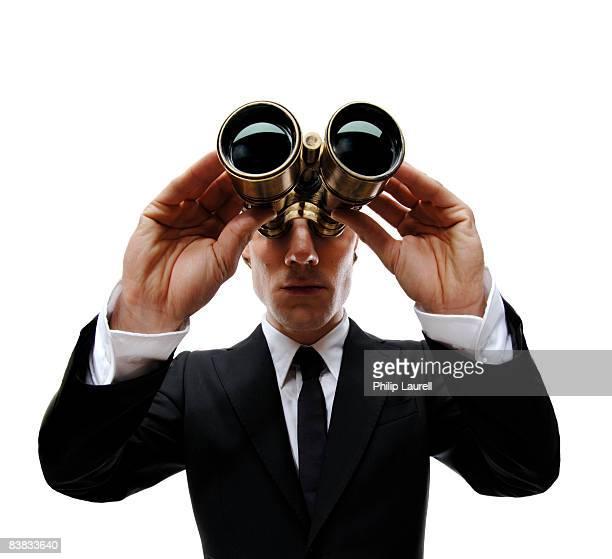 A man with binoculars Sweden.