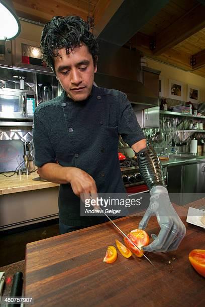 Man with bionic prosthetic hand preparing food.