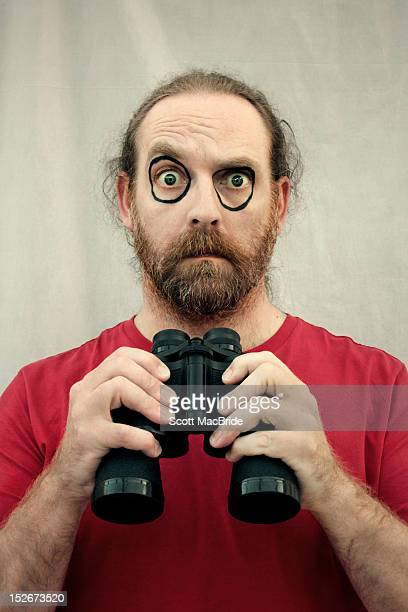 man with black rings around his eyes left from pai - scott macbride stock pictures, royalty-free photos & images