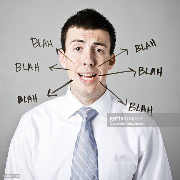 man with blah blah blah written around his face