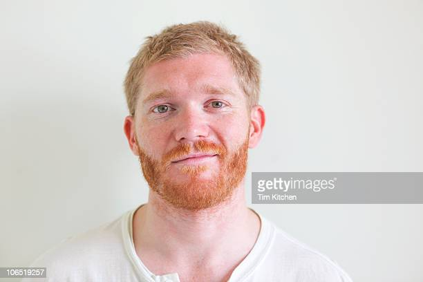 Man with blond hair and red beard, smiling