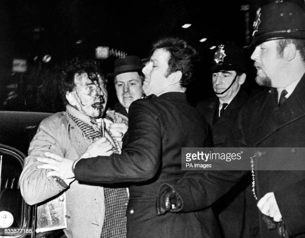 A man with blood streaming down his face is taken away to a police car in Oxford Street when demonstrators in Grosvenor Square moved down Oxford...