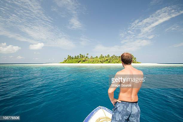 Man with boat, Baughagello Island, South Huvadhu Atoll, Maldives