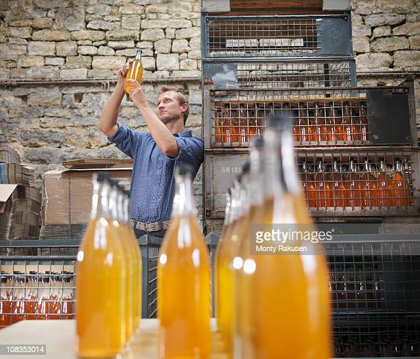 Man with bottle of organic cider