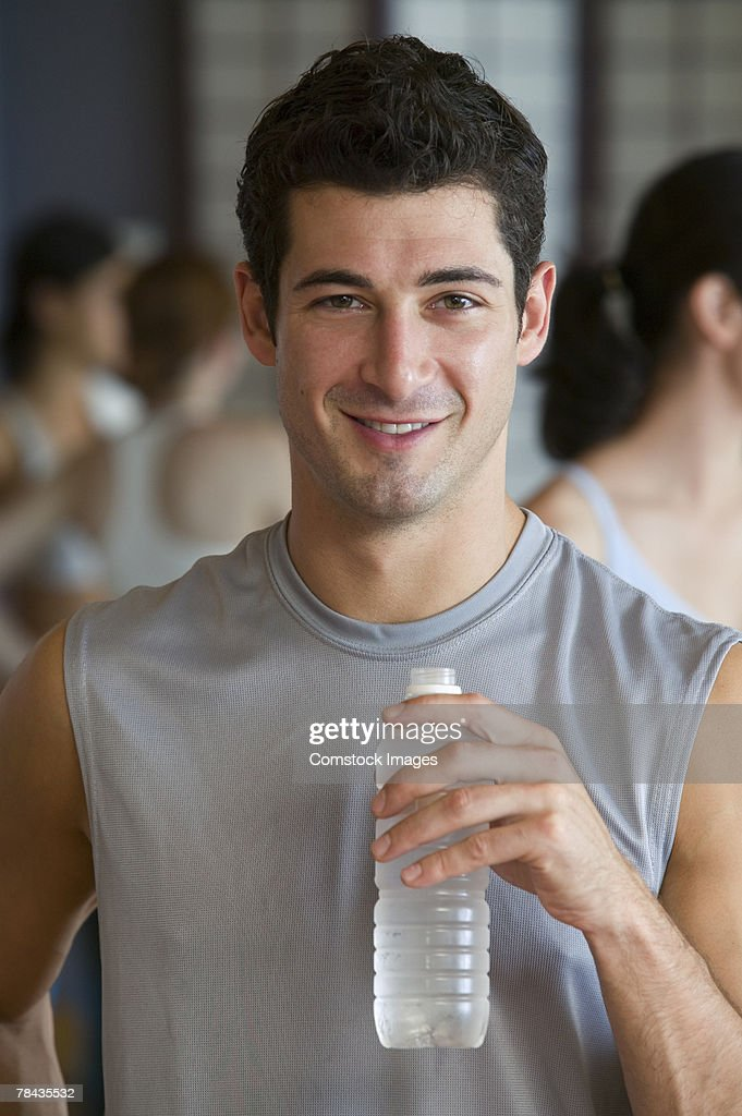 Man with bottled water : Stock Photo