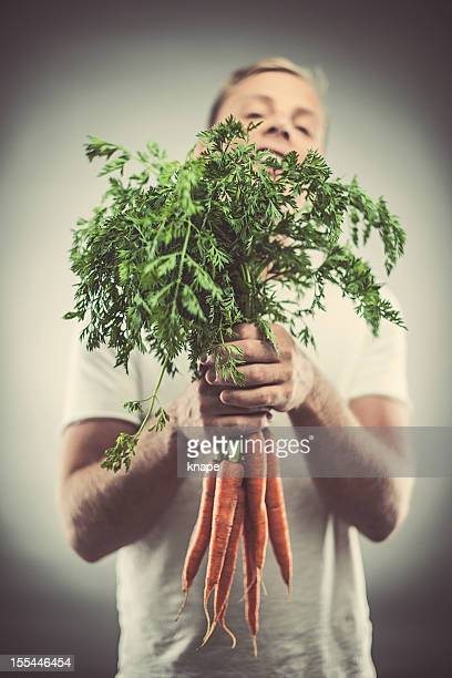 Man with bouquet of carrots