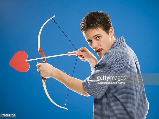 Man with bow and arrow with heart