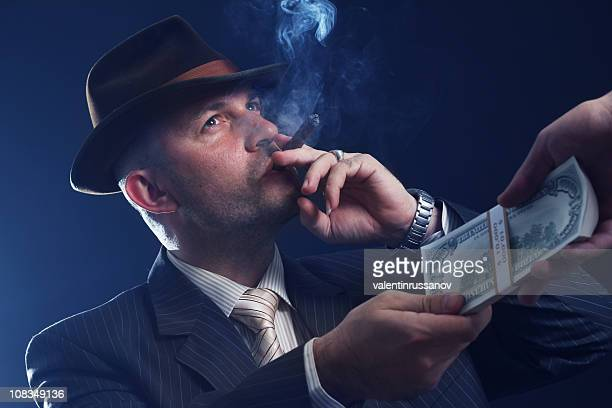 man with bowler hat and cigar - mafia stock pictures, royalty-free photos & images