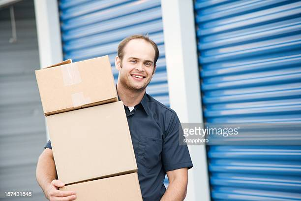 man with boxes moving company at self storage - self storage stock pictures, royalty-free photos & images