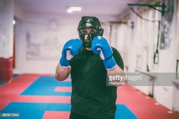 man with boxing equipment - headwear stock pictures, royalty-free photos & images