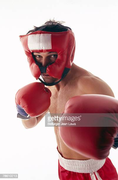 Man with boxing gloves and helmet