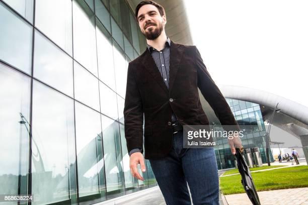Man with briefcase walking to walk