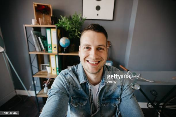 man with bright smile looking at camera - one man only stock pictures, royalty-free photos & images