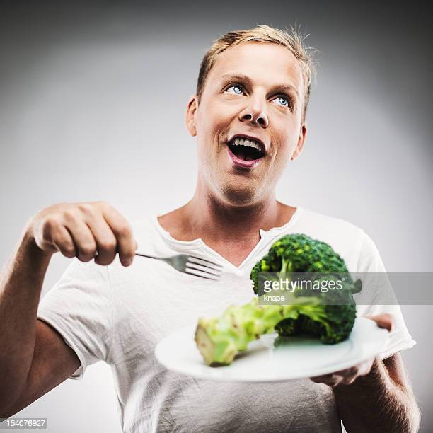 Man with broccoli on a plate