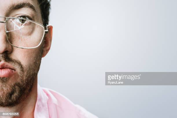 man with broken eyeglasses - eyeglasses stock photos and pictures