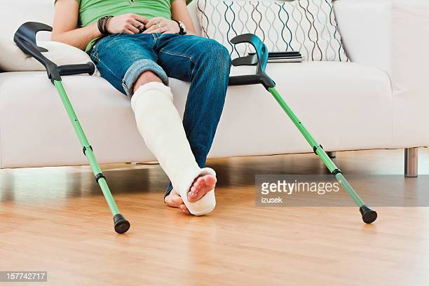 Man with broken leg at home