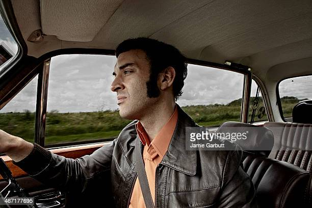 man with brown leather jacket u - sideburn stock pictures, royalty-free photos & images
