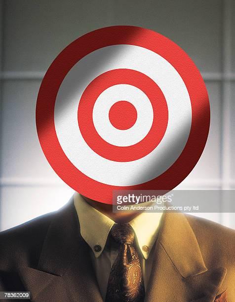 Man with bullseye over face
