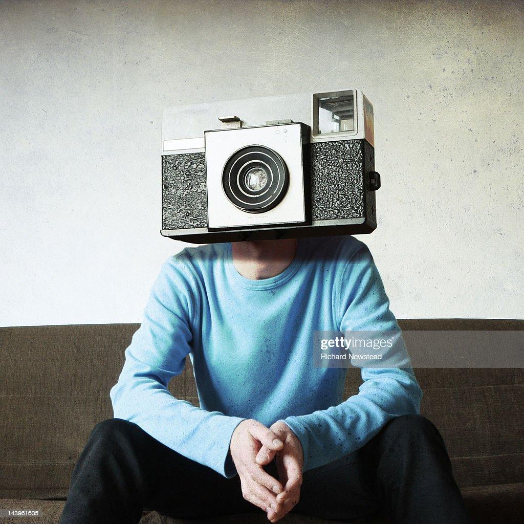 Man with camera his head : Stock Photo