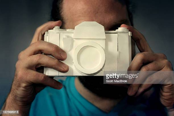 man with camera - scott macbride stock pictures, royalty-free photos & images