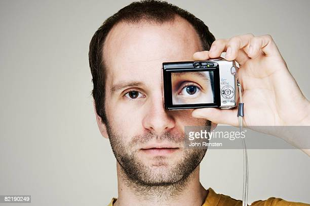 man with camera  - receding hairline stock pictures, royalty-free photos & images
