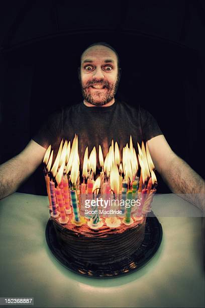 man with candles - scott macbride stock pictures, royalty-free photos & images