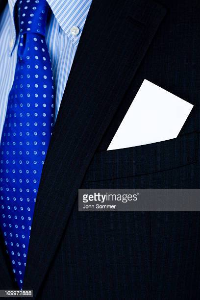 Man with card in his suit pocket