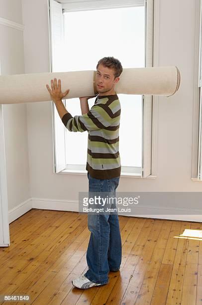 Man with carpet