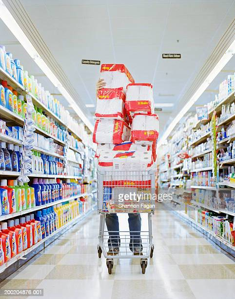 man with cart stacked with grocery - full stock pictures, royalty-free photos & images