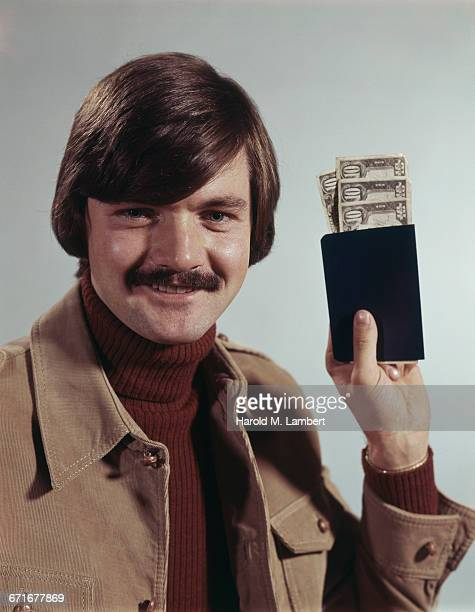 man with cash and bank book - {{relatedsearchurl(carousel.phrase)}} imagens e fotografias de stock
