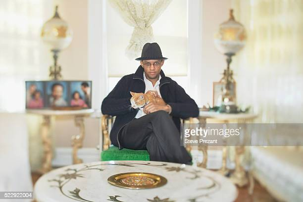 Man with Cat in Living Room