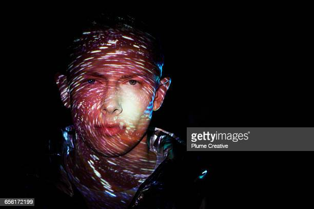 man with celestial shapes on his face - mystery stock pictures, royalty-free photos & images