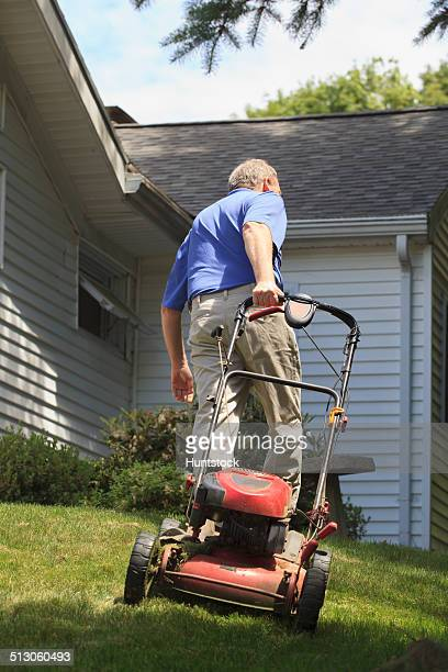 Man with Cerebral Palsy and dyslexia mowing his lawn