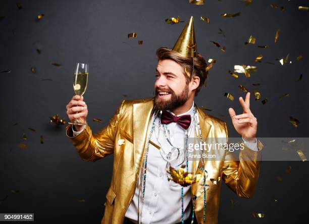 Man with champagne flute greeting new years day. Debica, Poland