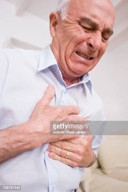 man with chest pain - heart disease stock pictures, royalty-free photos & images