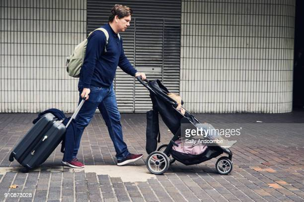 Man with child and suitcase