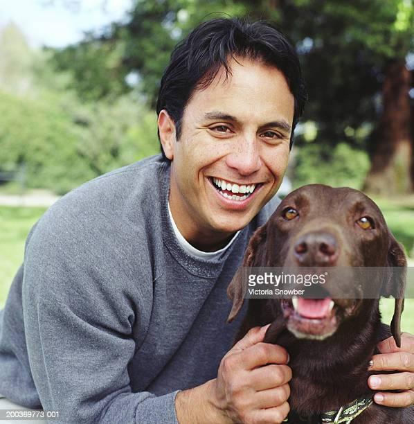 Man with Chocolate Labrador